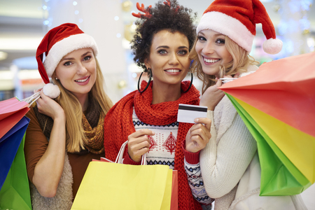 christmas lights display: Women paying with credit card for shopping Stock Photo