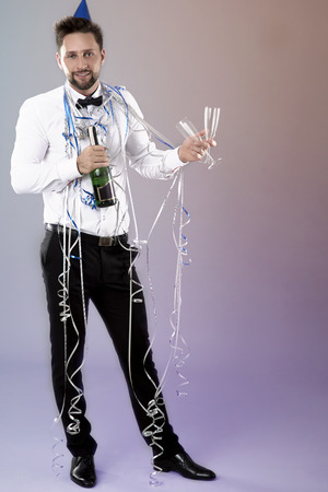 cheer full: Man with bottle of champagne on New Years Eve Stock Photo