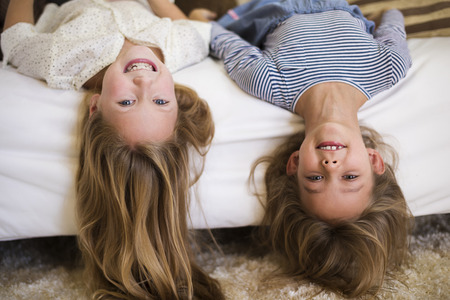 upside down: Cheerful girls upside down on the couch