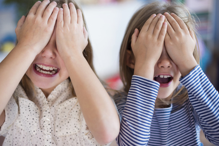 hide and seek: Little girls playing hide and seek Stock Photo