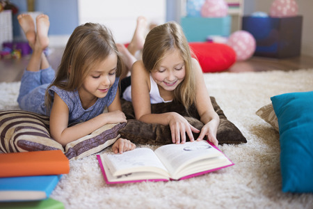 Reading interesting book with sister