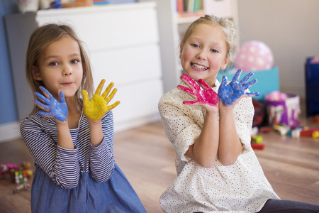 lower section view: Colorful hands presented by cute girls Stock Photo