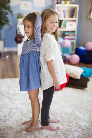 taller: Girls checking who is taller