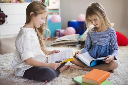 Siblings reading their favorite fairy tale