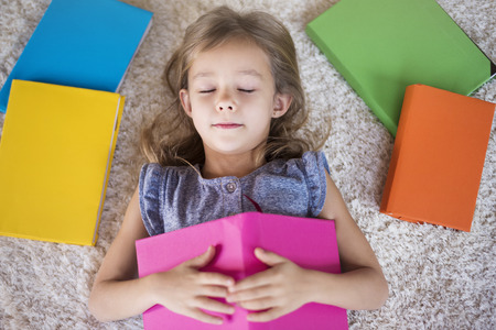bookworm: This girl is a real bookworm Stock Photo