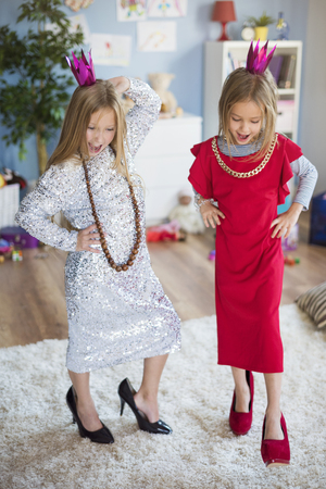 dressing up costume: Future models having fun in the living room