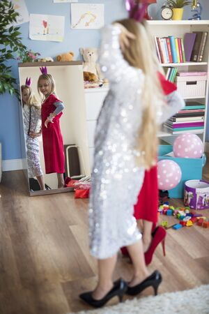 dress up: Girls having fun in front of the mirror