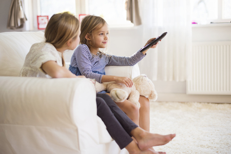 people watching tv: Who has a remote control, has the power
