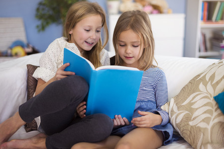 child reading book: This book is their favorite one