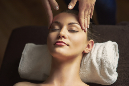 necked woman: Massage of head at the spa Stock Photo
