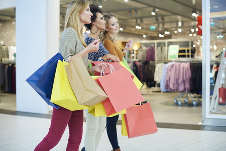 women smiling: Girls love shopping so much