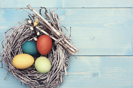 holiday decor: Easter nest with multi colorful eggs