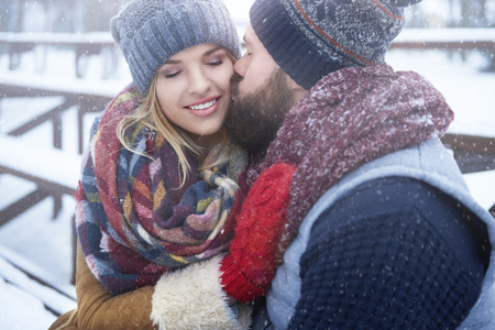 couple winter: Kissing couple in winter day Stock Photo