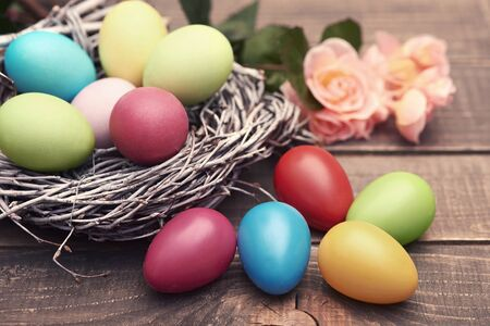 multi colored: Multi colored eggs on the brown planks Stock Photo