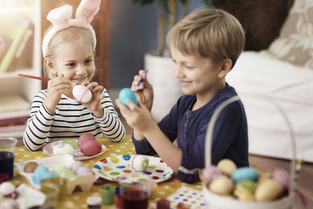 easter eggs: Little kids during the painting eggs