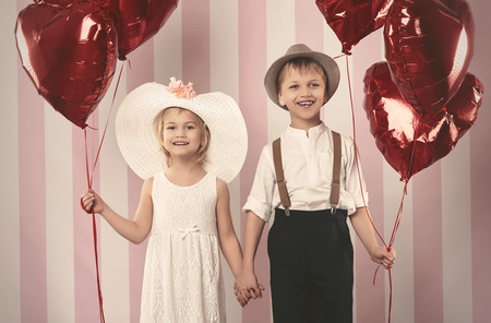 girl in a hat: Kid couple and bunch of balloons