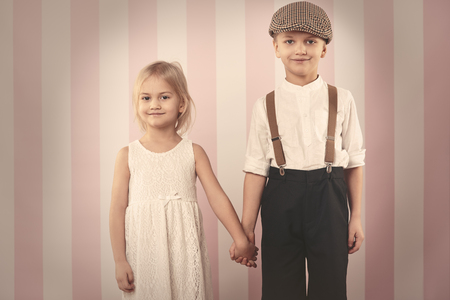boy lady: Cute child couple holding hands