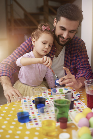 creative egg painting: Painting Easter eggs with father Stock Photo