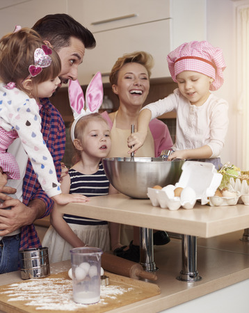 family time: Cheerful family spending time in the kitchen