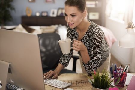 business woman working: Short break for sip of hot coffee