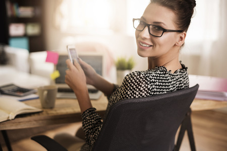 sitting at desk: Few text messages while working at the office