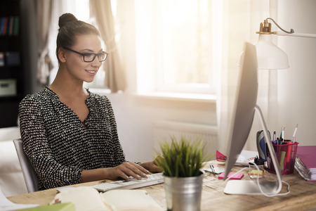 woman in office: Woman working in her home office