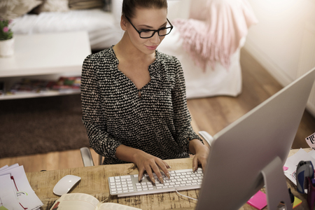 home office: High angle view of busy woman