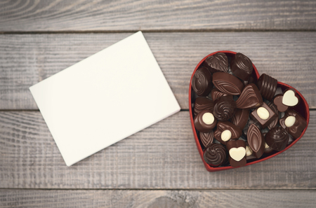 valentine hearts: Empty paper and opened chocolate box Stock Photo