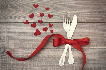heart in love: Bow of red ribbon around the silverware