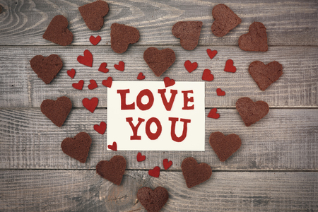love letter: Love letter in the middle of chocolate hearts Stock Photo