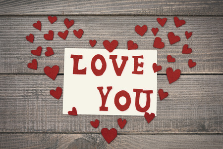 confessing: Confessing text and textile hearts Stock Photo