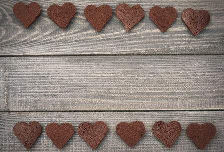 romantic heart: Two rows of homemade brownie hearts Stock Photo