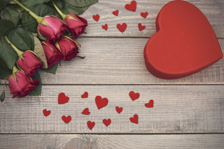 flower arrangement: Composition of red heart shapes and roses
