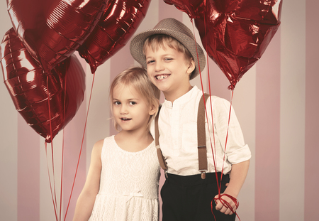 boy lady: Portrait of cute couple with balloons