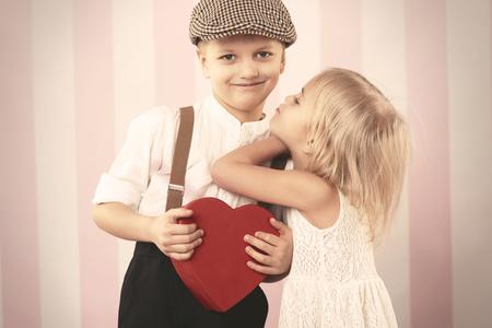 romantic heart: Girl trying to kiss her boyfriend Stock Photo