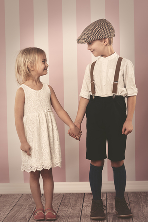 strongly: Cute children holding hands strongly