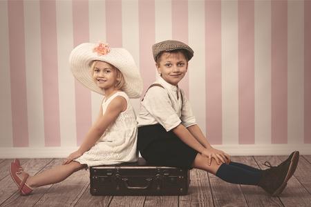 niños sentados: Portrait of children sitting on the chest Foto de archivo