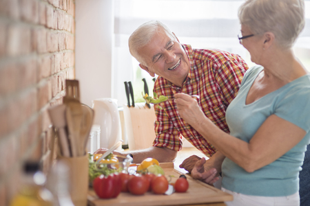 copy space: Senior marriage cooking together healthy meal