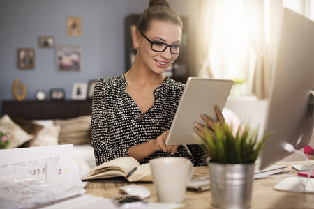 woman working: Woman very satisfied with her work Stock Photo