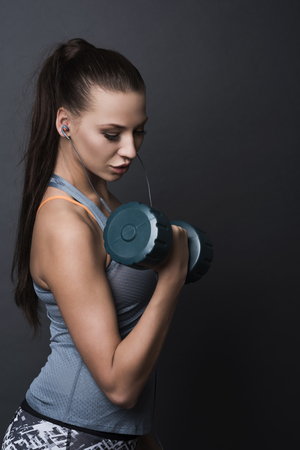 carried: Heavy dumbbell carried by a very strong woman Stock Photo