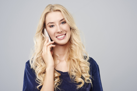 mobilephone: Blonde beautiful woman talking by mobilephone