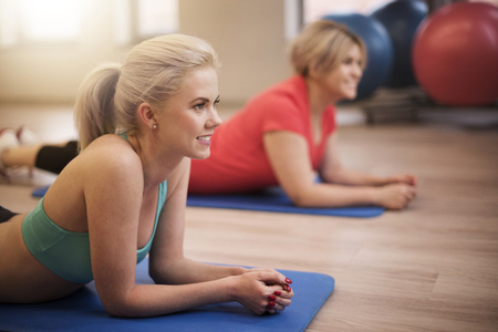 woman lying: Fitness is created for women