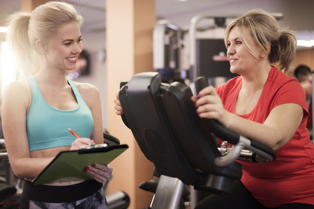 Working with personal trainer always gives good results Stock Photo - 53101160
