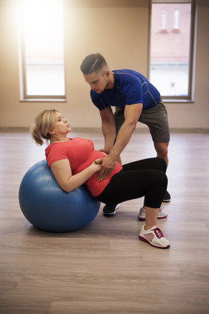 assisting: Its important to do exercises well Stock Photo