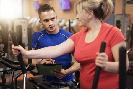 Personal trainer working with woman with overweight