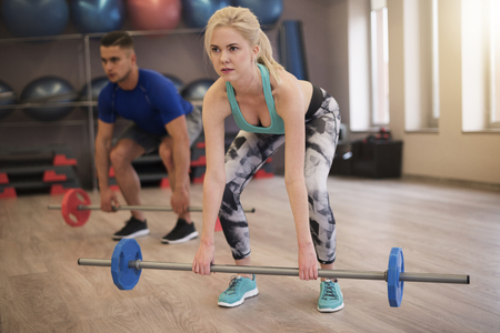 Couple doing dead lift together Stock Photo