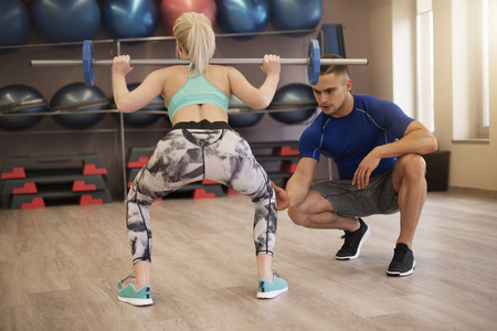 man gym: Trainer checking if everything is fine
