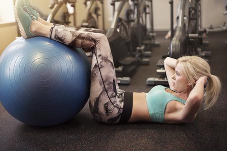 sit ups: Doing sit ups on fitness ball Stock Photo