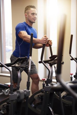 elliptical: Elliptical trainer and handsome man