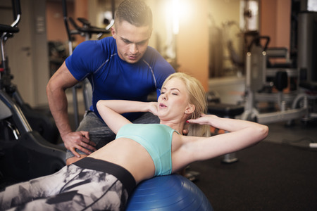 sit ups: Effective sit ups on fitness ball Stock Photo